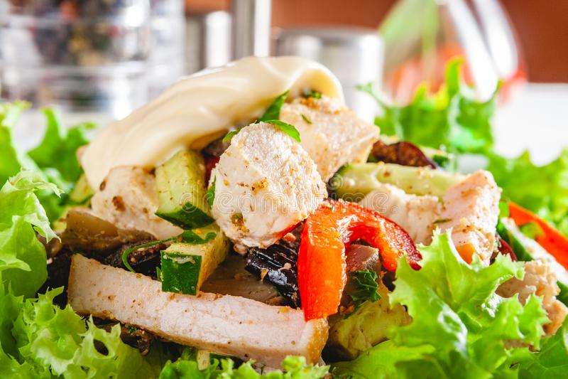 Salad with chicken breast and vegetables on white plate stock images