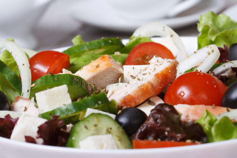 Salad with chicken, tomatoes, cucumbers, cheese macro royalty free stock images