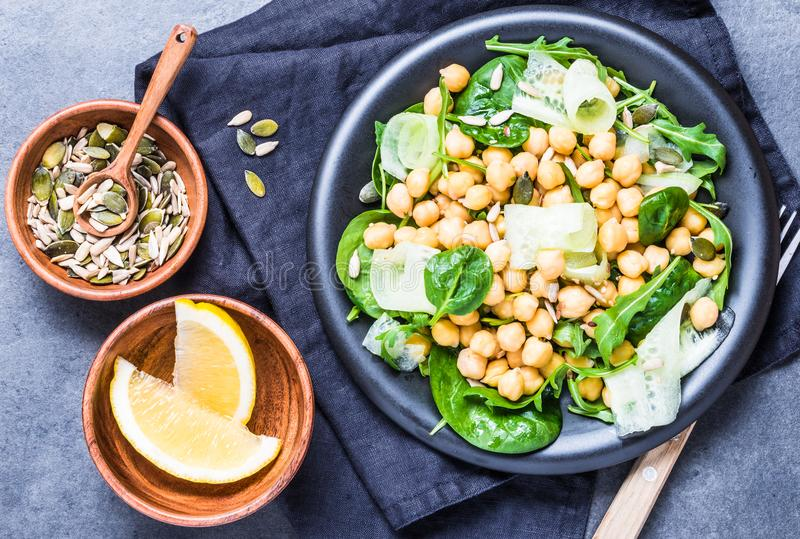 Salad with chickpea and greens, seeds top view.Vegan healthy food plate. royalty free stock images