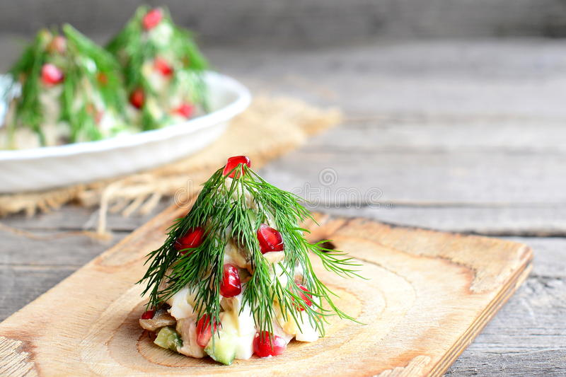Salad Christmas tree. Salad with meat, mushrooms, cucumbers and eggs decorated with dill. Christmas recipe. Old wooden background royalty free stock images