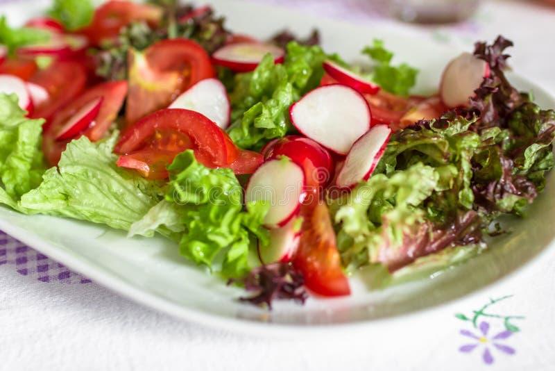 Salad. Close up of a salad of seasonal vegetables stock photos