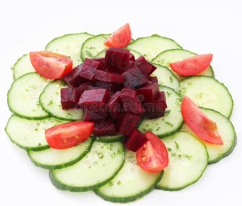 A salad of cucumber and red beet royalty free stock photo