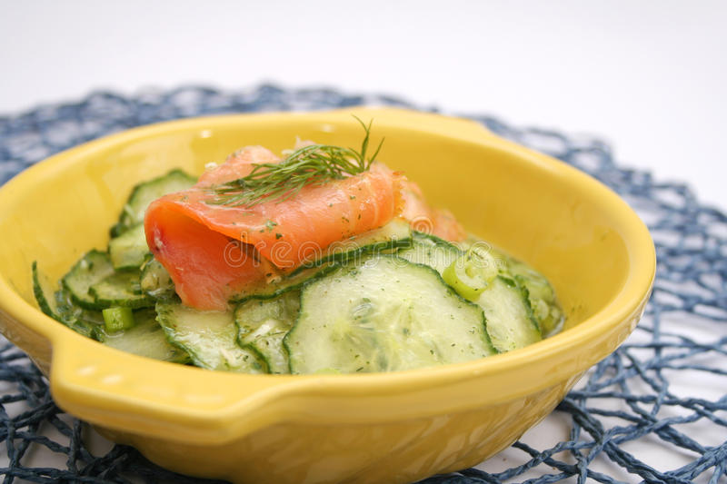 Salad of cucumber with salmon royalty free stock photo