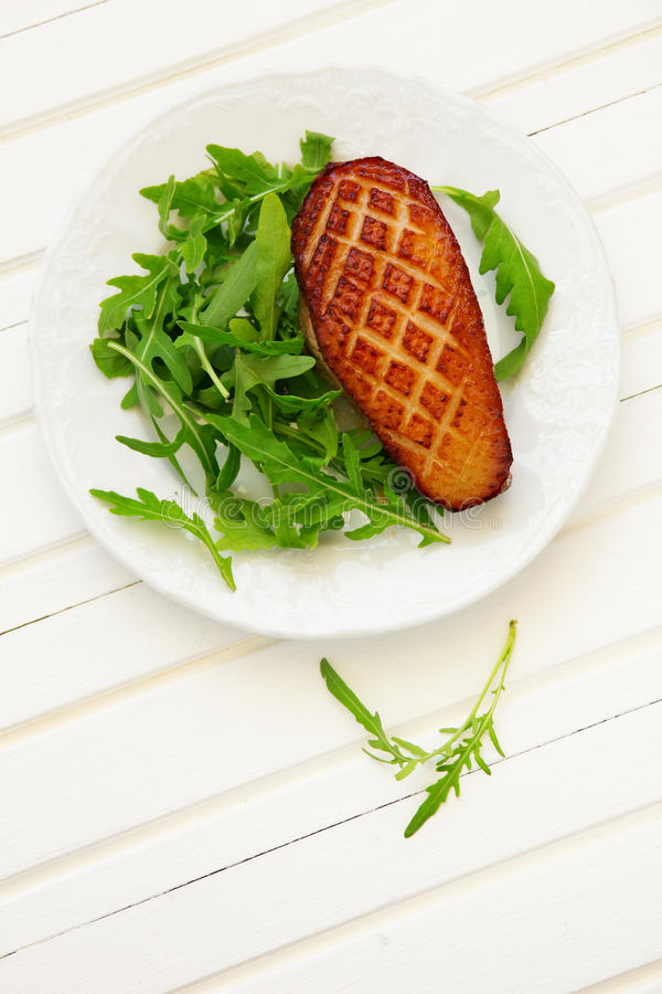 Salad with duck breast. royalty free stock photography