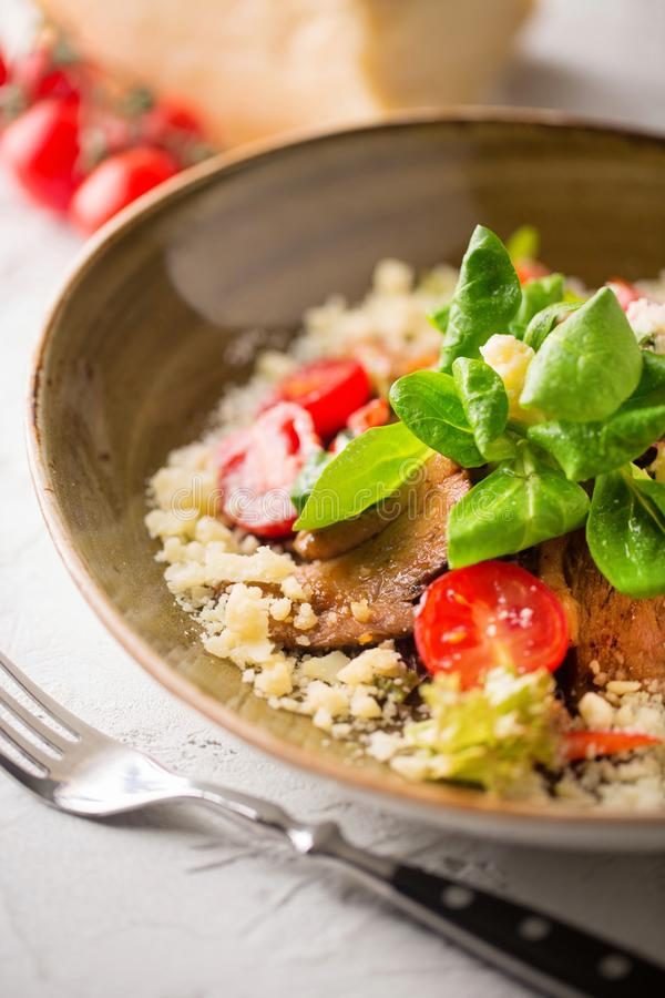 Salad with duck, tomatoes, cheese and corn stock image