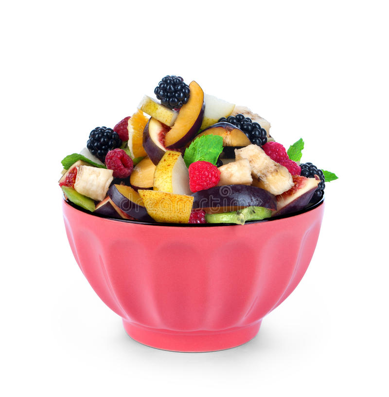 Salad of fresh fruit and berries in a bowl stock image