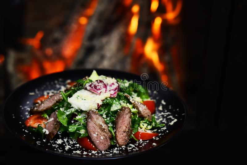 Salad with fresh vegetables and meat topped with cheese for healthy dieting. Dieting day. Healthy eating habits promote. Life royalty free stock image