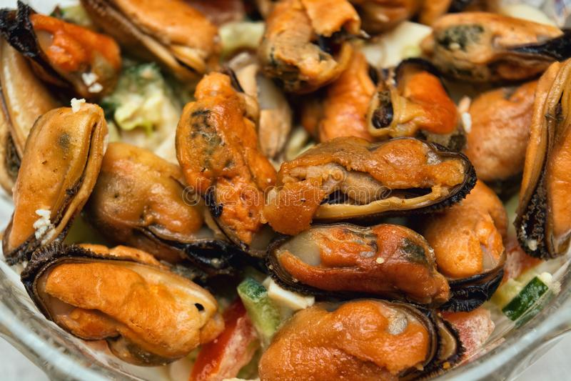 Salad with fried mussels on a plate, selective focus, close stock photography