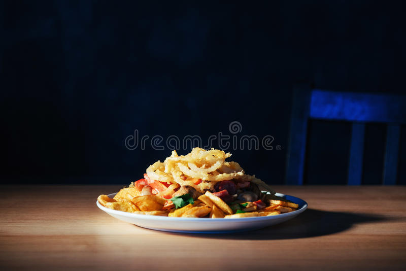 Salad with fried potatoes, mushrooms and tomatoes.  stock photo