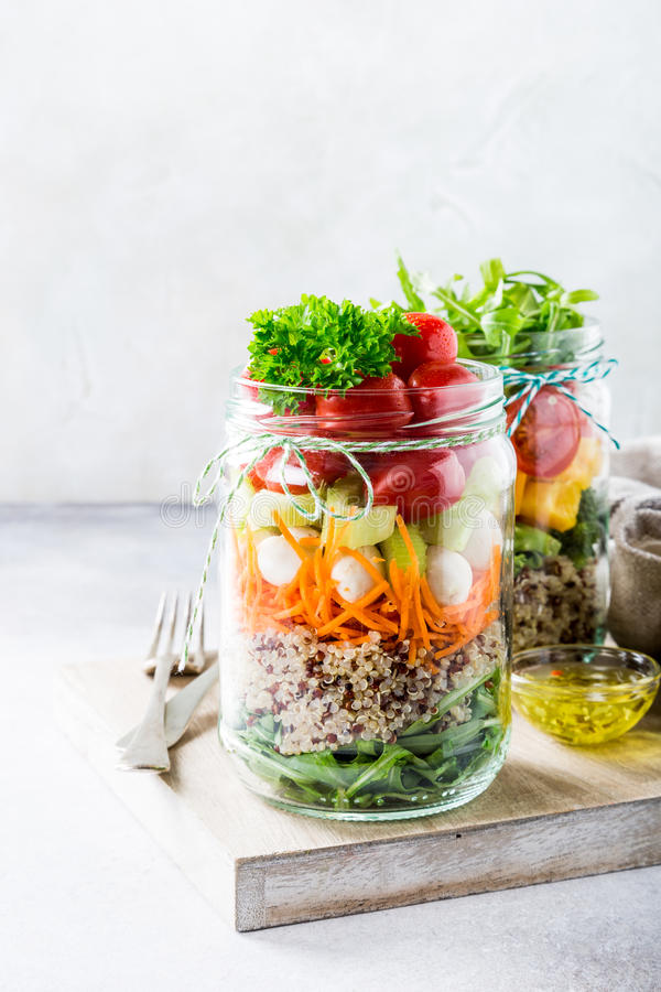 Salad in glass jar with quinoa stock photography