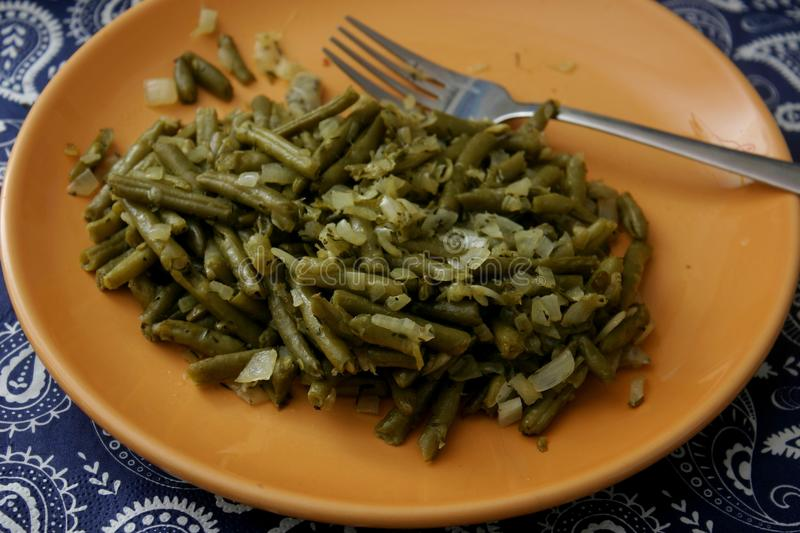 Salad of green beans. A salad of green beans with onions stock images