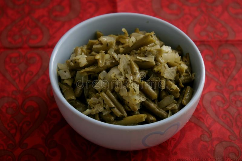 Salad of green beans. A salad of green beans with onions, vinegar and oil stock photos