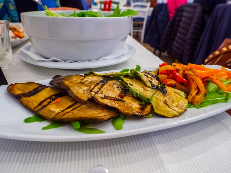 Salad with grilled aubergines, peppers and zucchini royalty free stock image