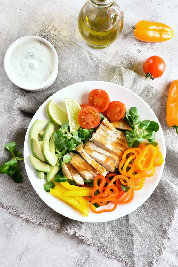 Salad with grilled chicken breast and fresh vegetables royalty free stock photo
