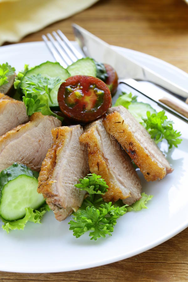 Salad with grilled duck fillet, tomato stock photography