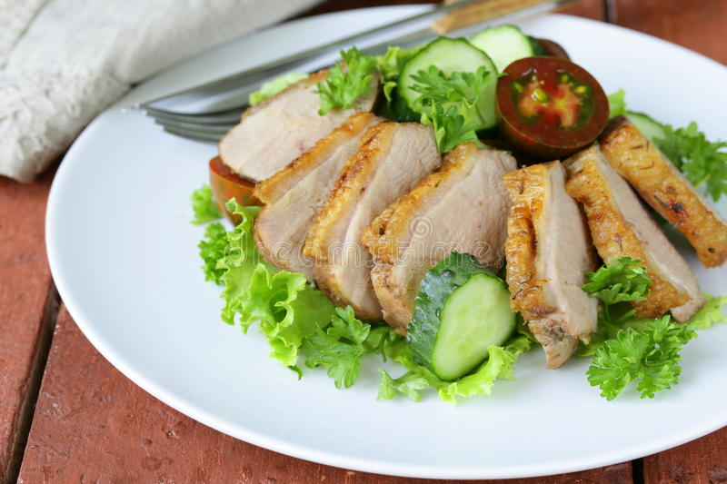 Salad with grilled duck fillet, tomato royalty free stock image