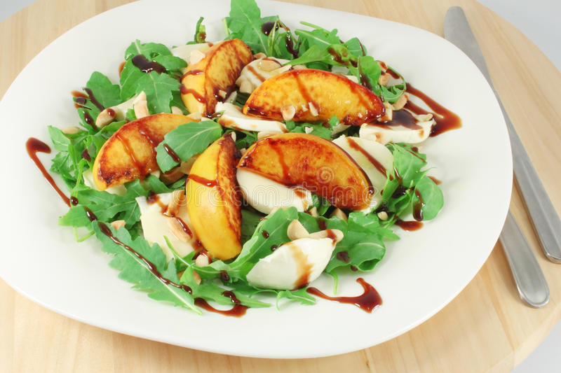 Salad with grilled peach royalty free stock photos