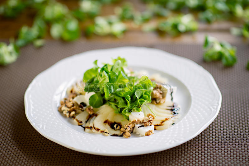 Salad with Grilled Pears, Walnuts and Goat Cheese, Close Up stock photos