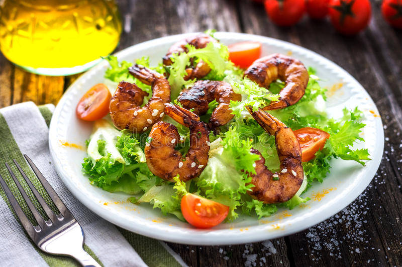 Salad with grilled prawns. And cherry tomatoes stock photography