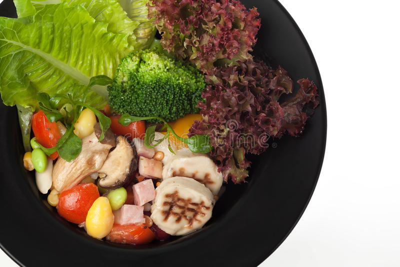 Salad isolated. Mixed salad with fresh vegetable isolated on white stock photography