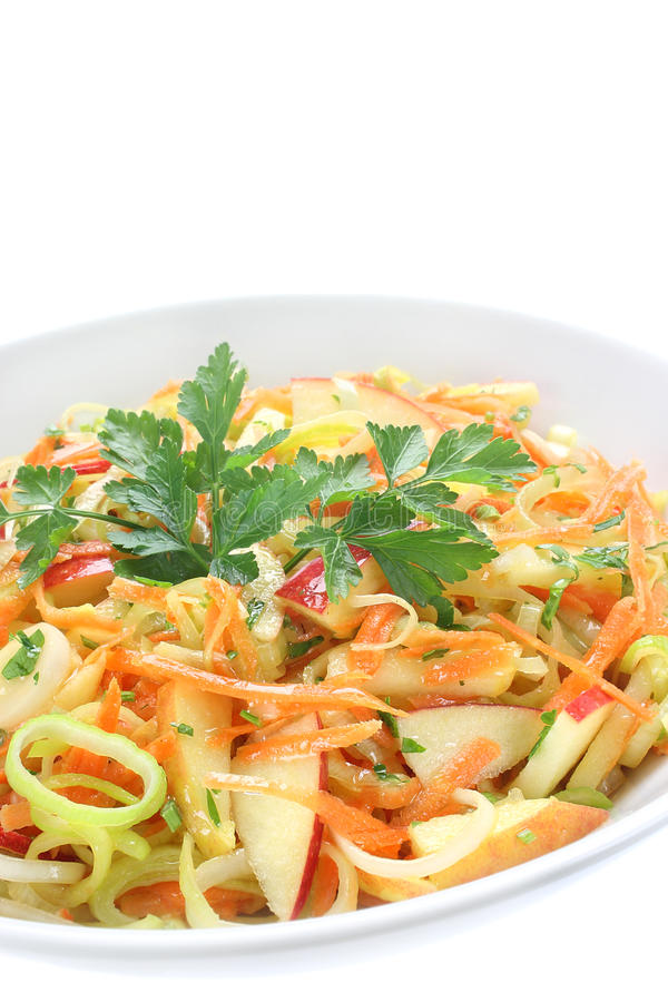 Salad with leek. Carrots and apples stock images