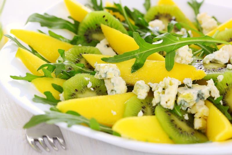 Salad with mango, kiwi and blue cheese stock photo