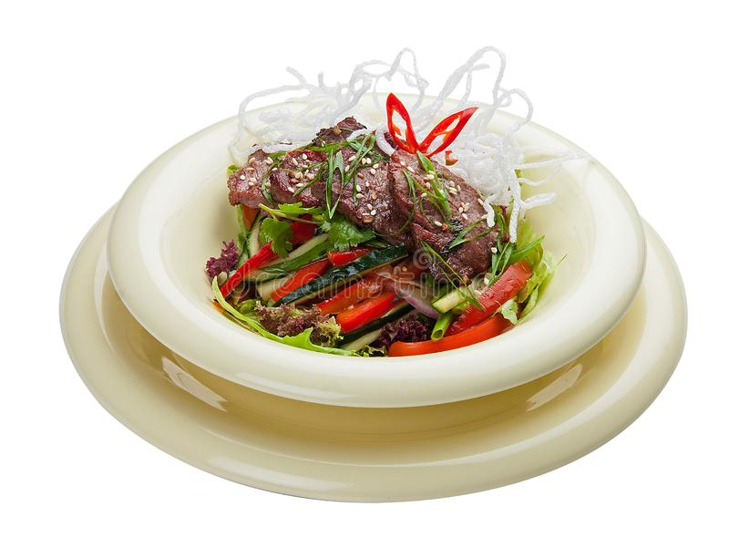 Salad with marinated veal and vegetables. Asian cuisine royalty free stock photo
