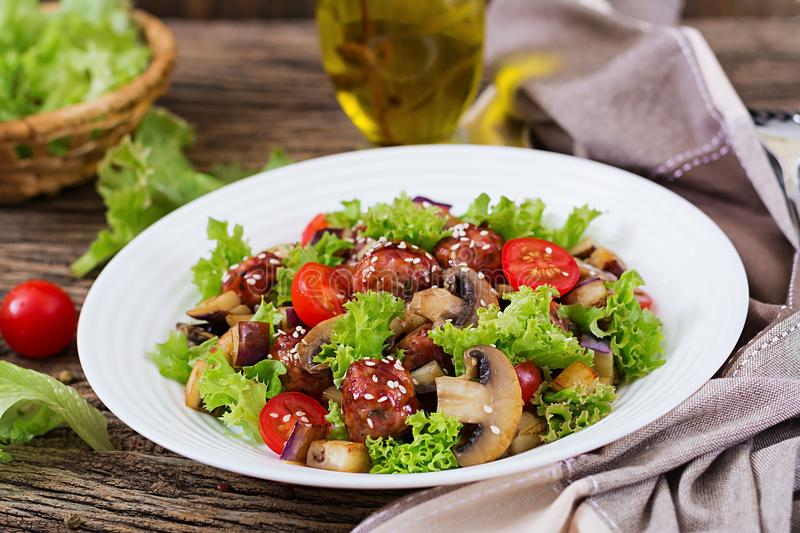 Salad with meatballs, eggplant, mushrooms and tomatoes in Asian style. Healthy food. Diet meal stock image