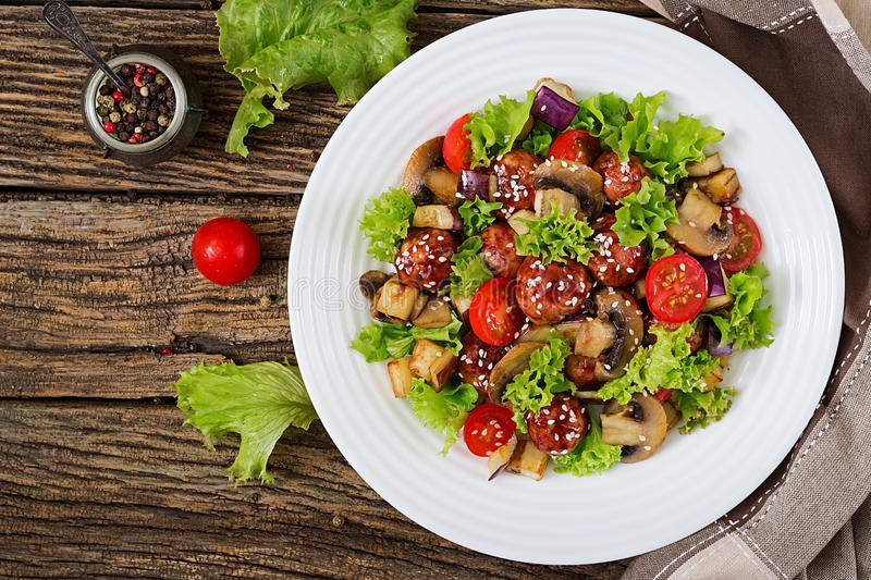 Salad with meatballs, eggplant, mushrooms and tomatoes in Asian style. Healthy food. Diet meal. Top view. Flat lay royalty free stock images