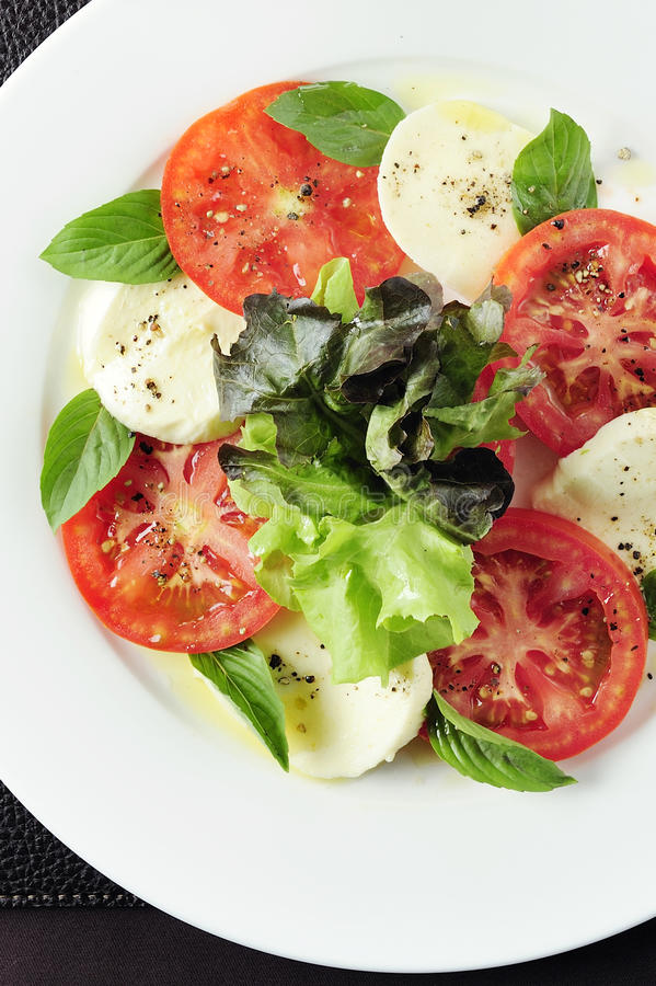 Salad with mozzarella. Tomatoes and basil stock images