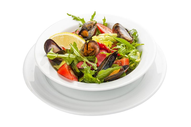 Salad with mussels and chorizo. A traditional Spanish dish. royalty free stock photography