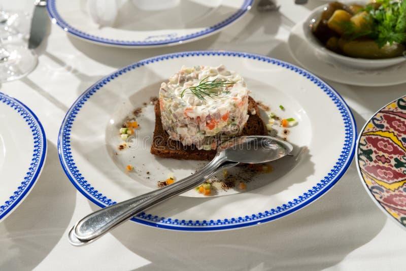 Salad Olivier em uma placa foto de stock royalty free
