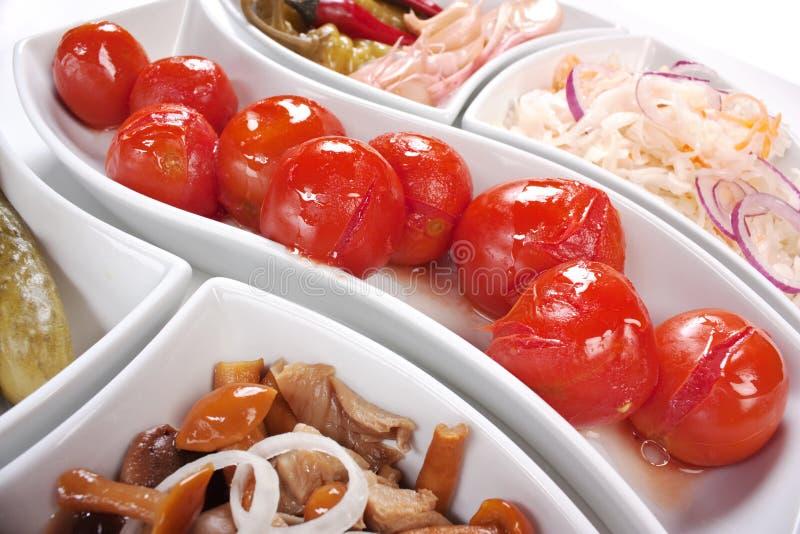 Salad of pickled vegetables stock image