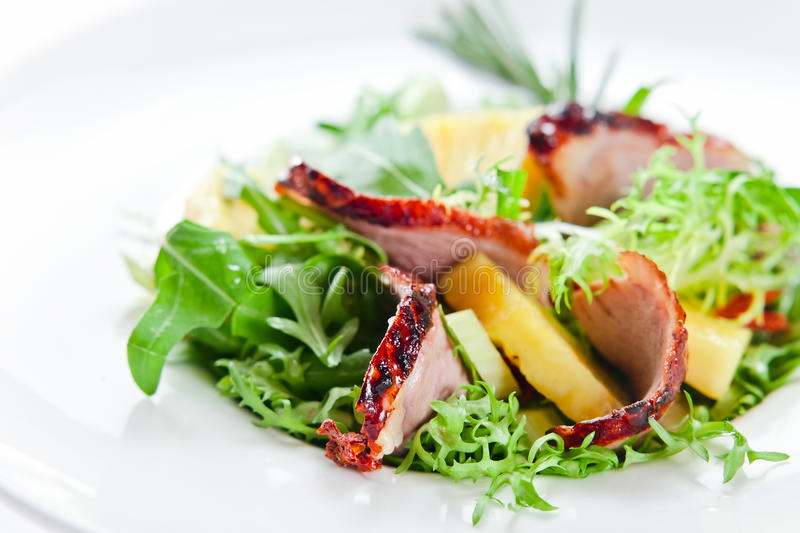 Salad with pineapple and smoked meat stock photography