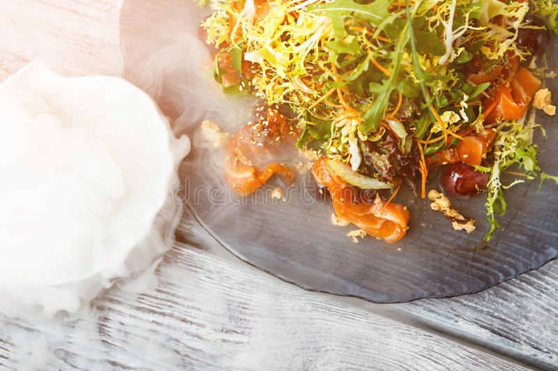 Salad plate and dry ice. stock images