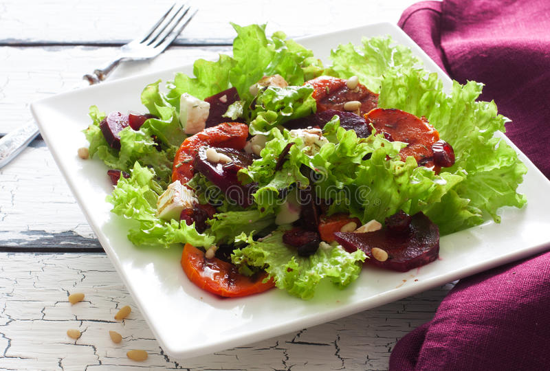 Salad with pumpkin, beet, soft cheese and lettuce. Salad with pumpkin, beet, blue cheese and lettuce in white plate stock image