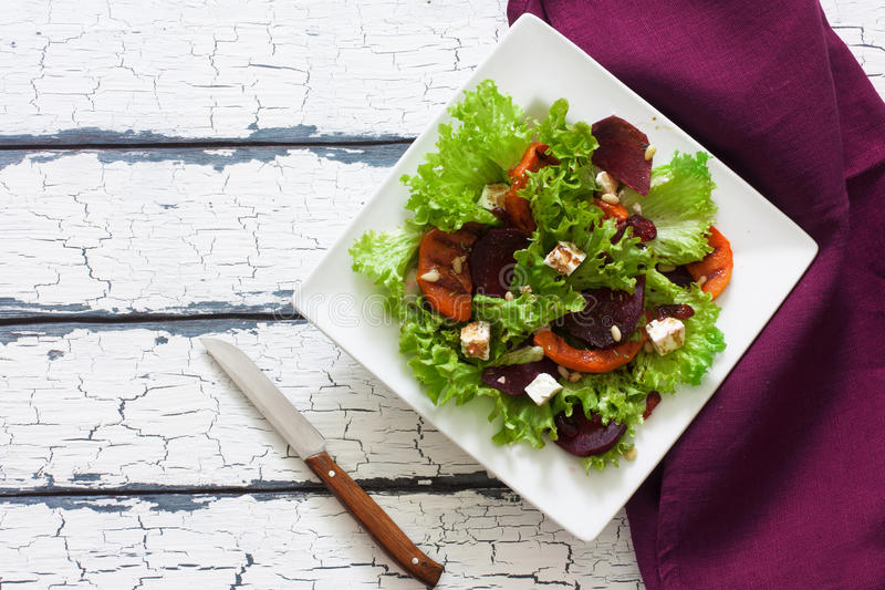 Salad with pumpkin, beet, soft cheese and lettuce. Top view royalty free stock photography