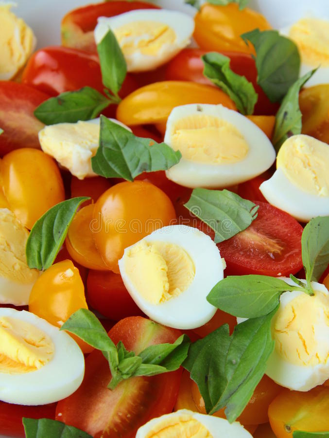 Download Salad With Quail Eggs And Cherry Tomatoes Stock Photo - Image: 21095816