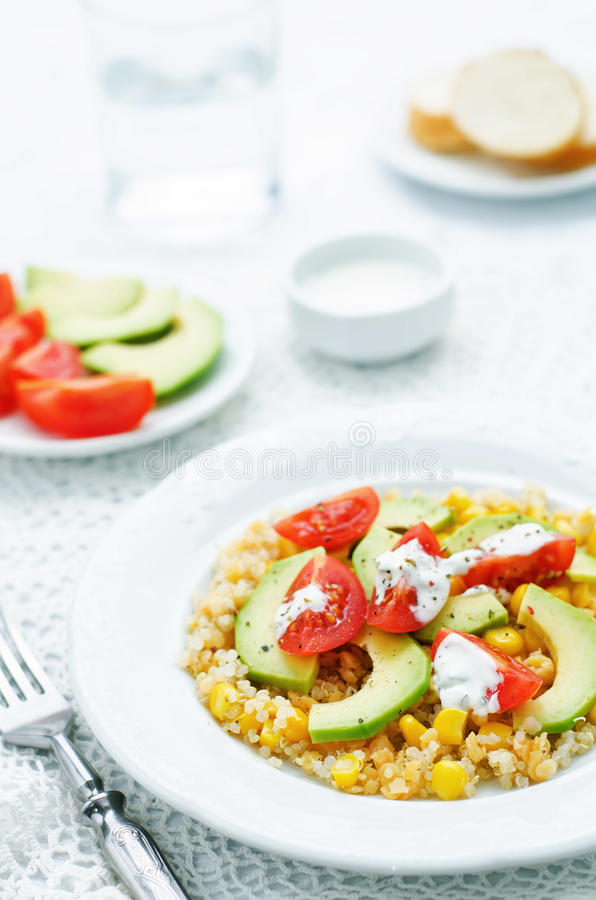 Download Salad With Quinoa, Red Lentils, Corn, Avocado And Tomato With Yo Stock Photo - Image of section, plant: 51082482