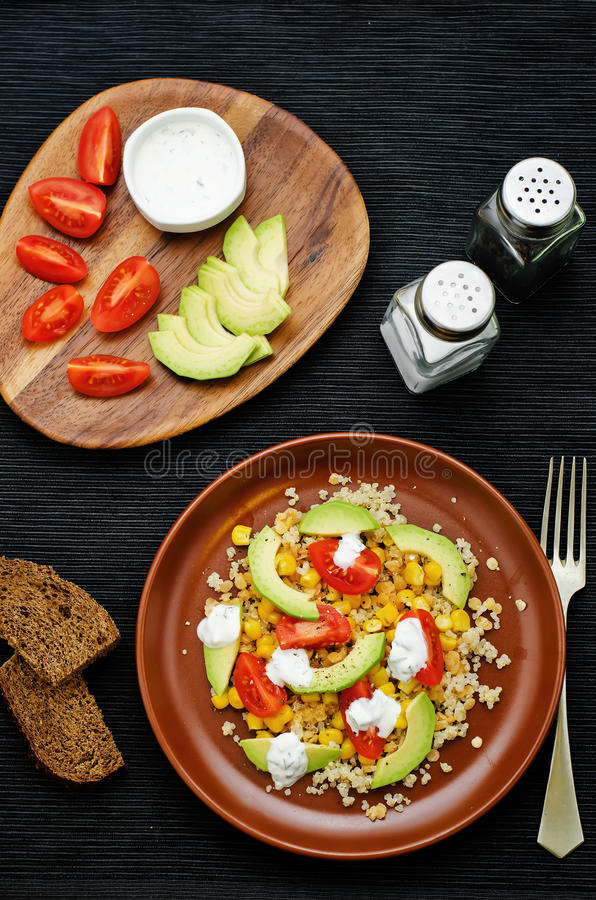 Download Salad With Quinoa, Red Lentils, Corn, Avocado And Tomato With Yo Stock Photo - Image of dark, dish: 51082584