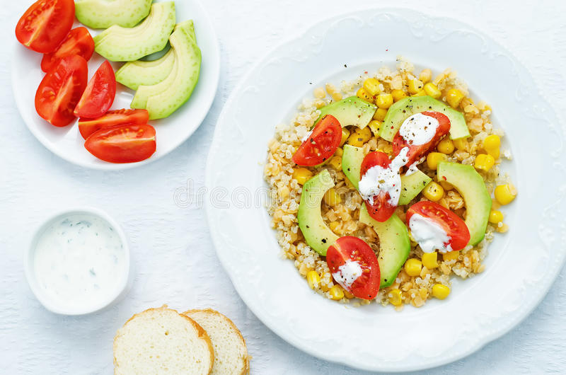 Download Salad With Quinoa, Red Lentils, Corn, Avocado And Tomato With Yo Stock Photo - Image of section, plant: 51082600