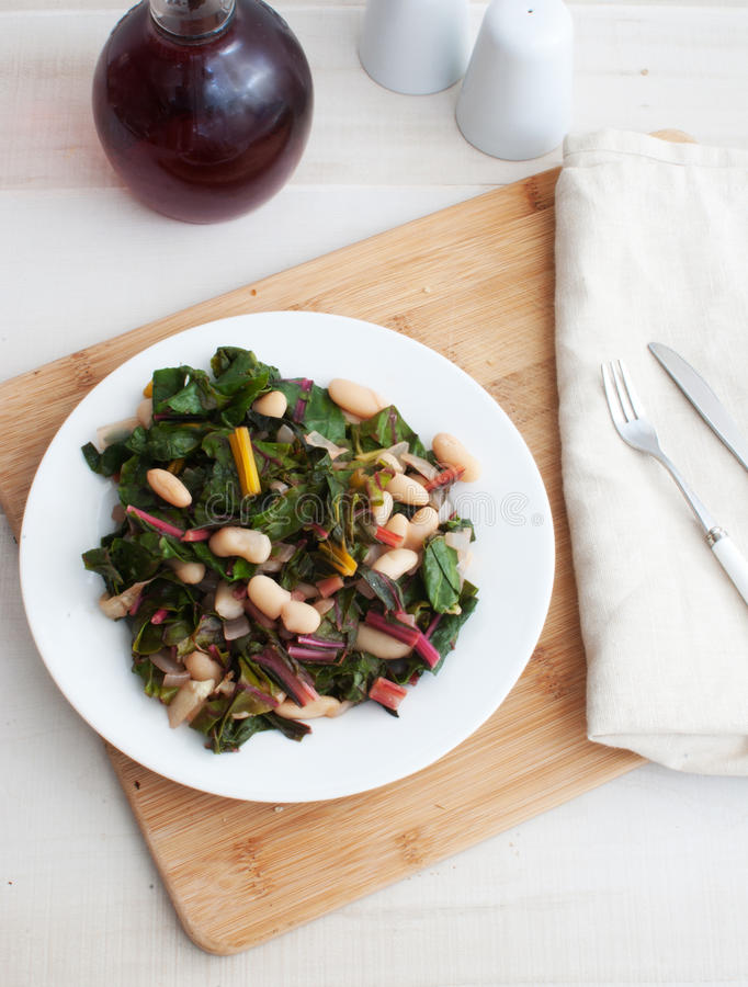 Salad with rainbow chard and beans. Top view royalty free stock photos