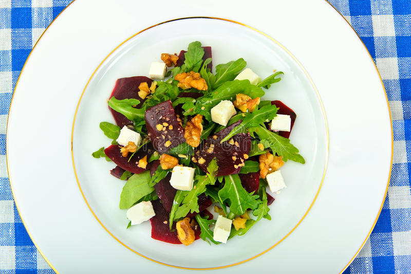 Salad of Raw Beets, Pears, Arugula, Roots, Sunflower Seeds and C. Heese. Studio Photo stock image