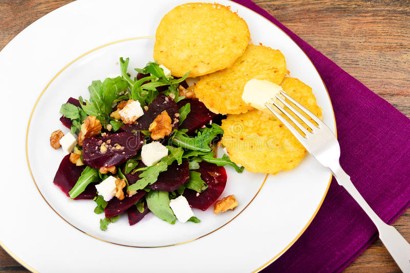 Salad of Raw Beets, Pears, Arugula, Roots, Sunflower Seeds and C. Heese. Studio Photo royalty free stock photography