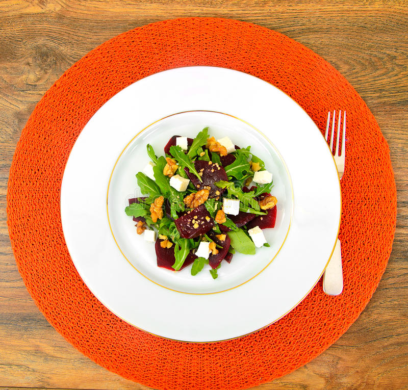 Salad of Raw Beets, Pears, Arugula, Roots, Sunflower Seeds and C. Heese. Studio Photo royalty free stock image