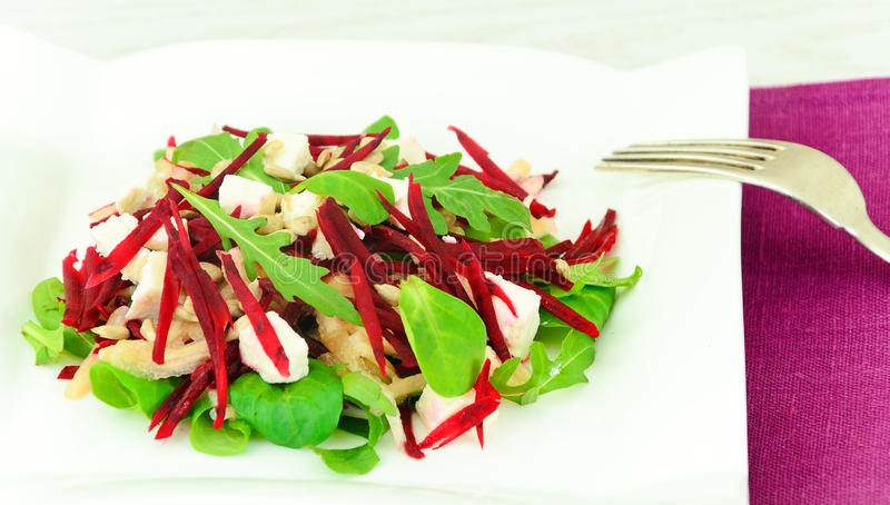 Salad of Raw Beets, Pears, Arugula, Roots. Sunflower Seeds and Cheese. Studio Photo royalty free stock photography