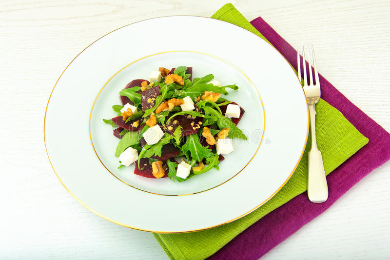 Salad of Raw Beets, Pears, Arugula, Roots. Sunflower Seeds and Cheese. Studio Photo royalty free stock images