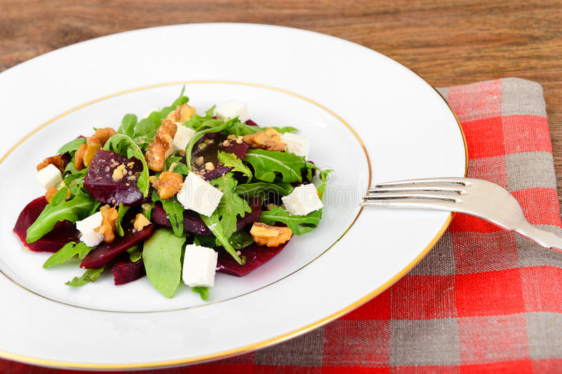 Salad of Raw Beets, Pears, Arugula, Roots. Sunflower Seeds and Cheese. Studio Photo royalty free stock photos