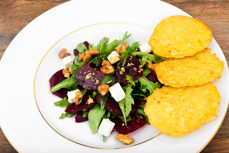 Salad of Raw Beets, Pears, Arugula, Roots. Sunflower Seeds and Cheese. Studio Photo stock image