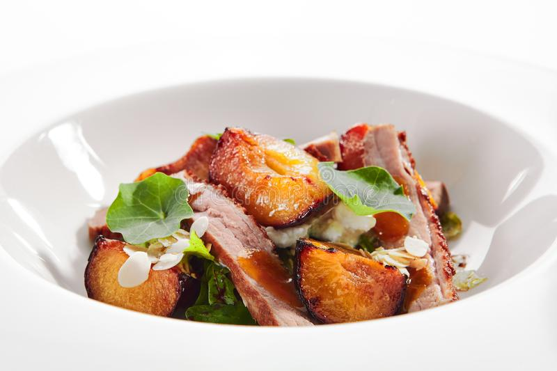 Salad with Roasted Duck Breast, Baked Pear and Strachatella royalty free stock photography